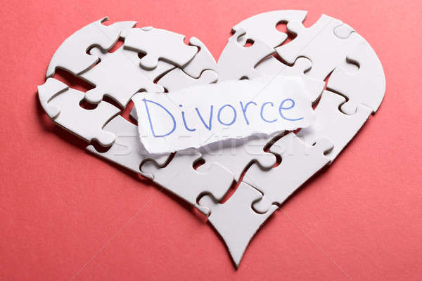 Stock photo: Divorce Label On Heart Made Of Puzzle