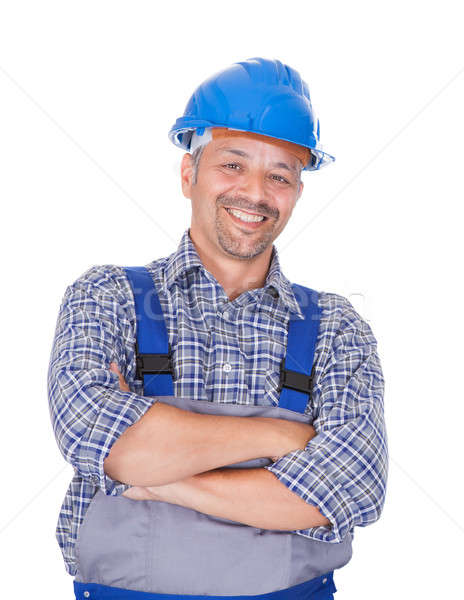 Happy Manual Worker Standing Arms Crossed Stock photo © AndreyPopov