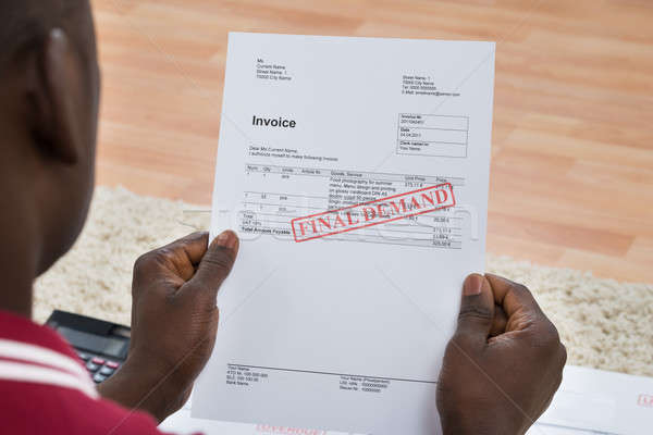 Man Holding Invoice With Final Demand Notification Stock photo © AndreyPopov