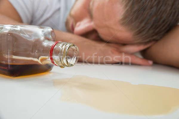 Részeg férfi üveg szeszes ital fiatal alszik Stock fotó © AndreyPopov