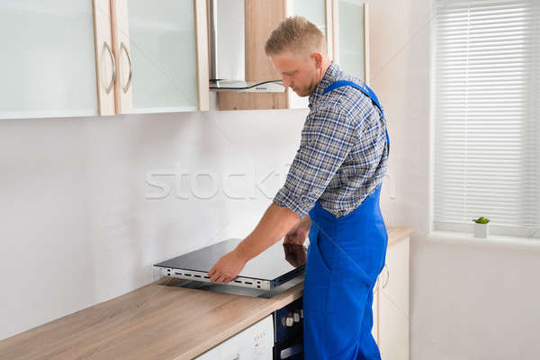 Repairman Installing Induction Cooker Stock photo © AndreyPopov