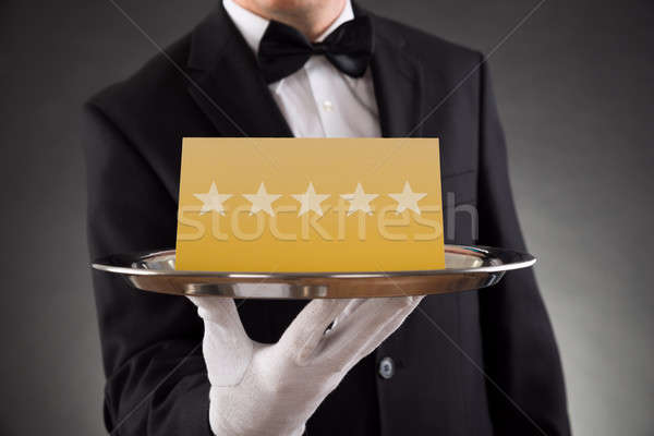 Waiter Serving Star Rating Stock photo © AndreyPopov