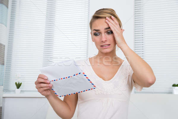 Shocked Woman Reading Letter At Home Stock photo © AndreyPopov