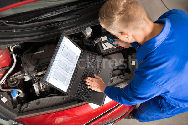 Mechanic Using Laptop To Repair Car Stock photo © AndreyPopov
