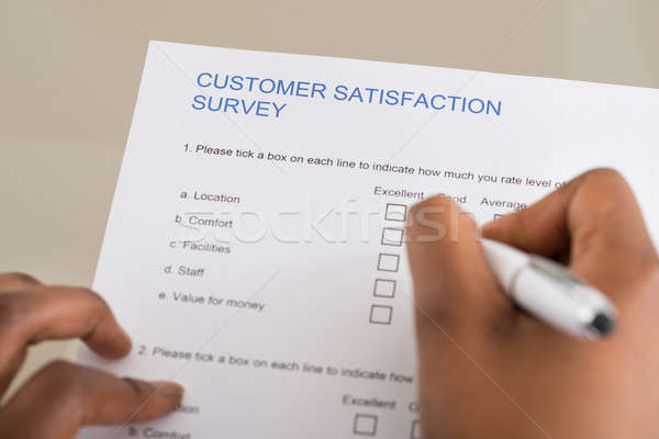 Person Filling Customer Satisfaction Form Stock photo © AndreyPopov