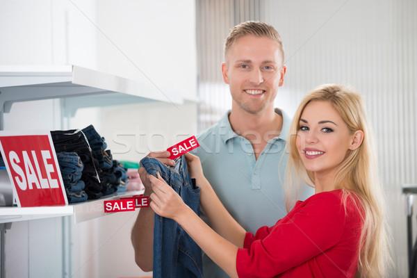 Happy Couple Choosing New Jeans  Stock photo © AndreyPopov
