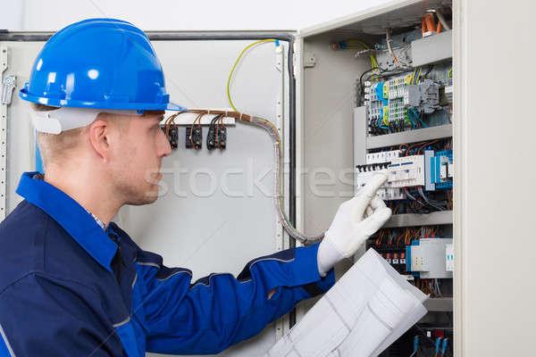 Male Electrician Testing Fusebox Stock photo © AndreyPopov