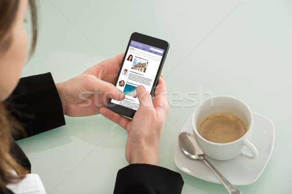 Businesswoman Surfing Social Networking Site On Mobilephone Stock photo © AndreyPopov