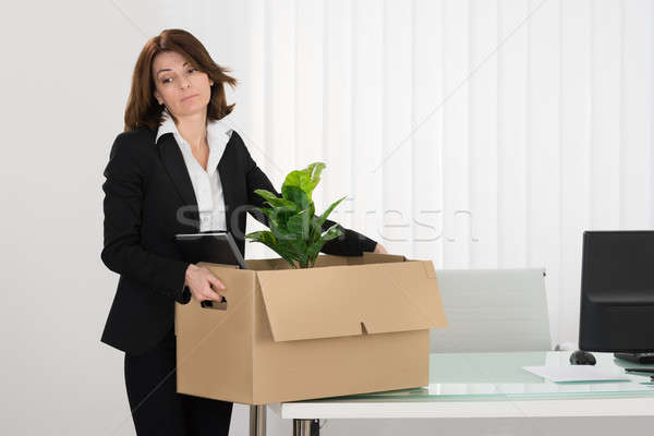 Sad Businesswoman Packing Her Belongings In Box Stock photo © AndreyPopov