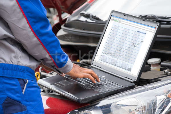 Mechanic Using Laptop For Examining Car Engine Stock photo © AndreyPopov