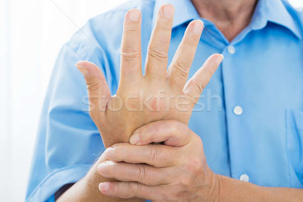 Person's Hand With Pain On The Wrist Stock photo © AndreyPopov