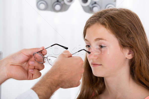 An Optician Helping Girl With New Eyeglasses Stock photo © AndreyPopov