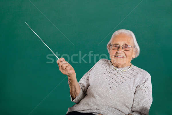 Happy Female Teacher In Classroom Stock photo © AndreyPopov