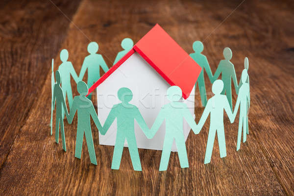 House Model With Papercut On Wooden Desk Stock photo © AndreyPopov