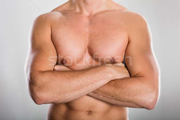 Hombre muscular construir primer plano sin camisa gris Foto stock © AndreyPopov