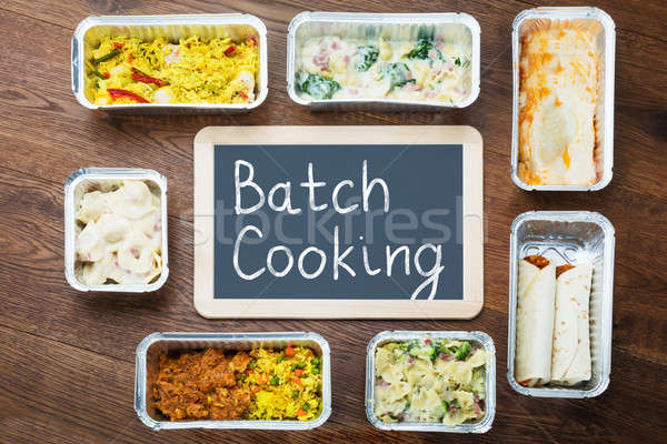 Batch Cooking Text Written On Slate With Take Away Dishes Stock photo © AndreyPopov