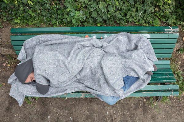 Homeless Man Sleeping On Bench Stock photo © AndreyPopov