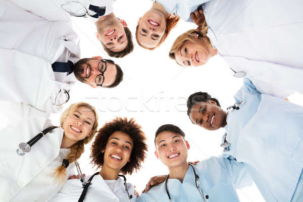 Happy Medical Team Forming Huddle Stock photo © AndreyPopov