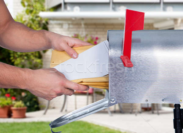 Man Taking The Letters From Mailbox Stock photo © AndreyPopov