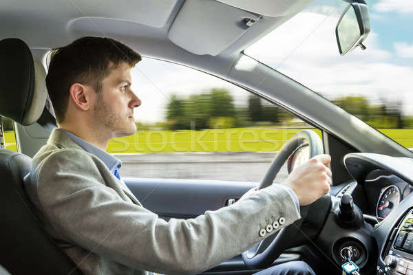 Young Man Driving Car Stock photo © AndreyPopov