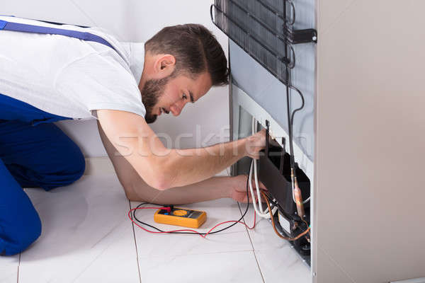 Male Technician Examining Refrigerator Stock photo © AndreyPopov