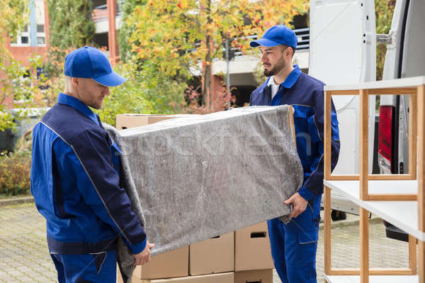 Two Male Worker Unloading Furniture From Truck Stock photo © AndreyPopov