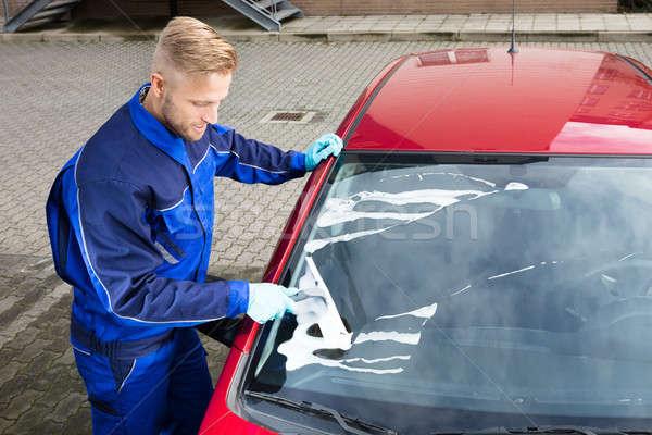 Munkás mosás szélvédő autó víz munka Stock fotó © AndreyPopov