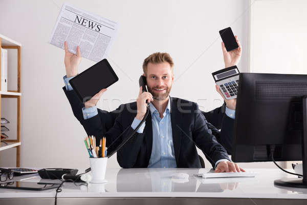 Imprenditore multitasking ufficio ritratto felice giovani Foto d'archivio © AndreyPopov
