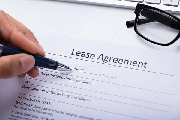 Person Filling Lease Agreement Form Stock photo © AndreyPopov