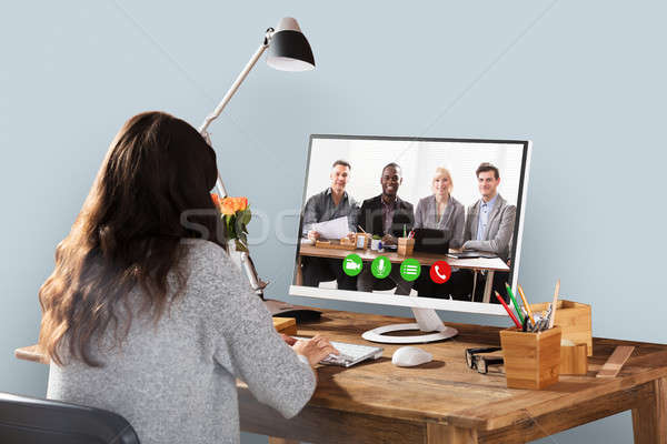 Woman Video Conferencing With Colleagues On Computer Stock photo © AndreyPopov