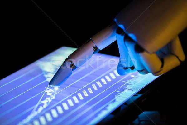 Robot Using Digital Tablet Stock photo © AndreyPopov