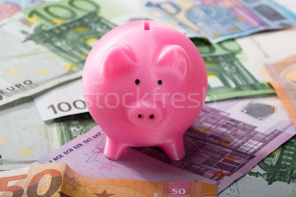Close-up Of Piggy Bank On Banknotes Stock photo © AndreyPopov