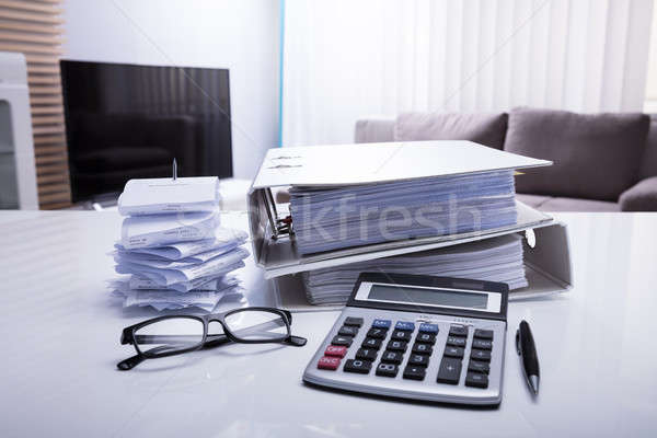 Close-up Of Folders With Receipts And Calculator Stock photo © AndreyPopov