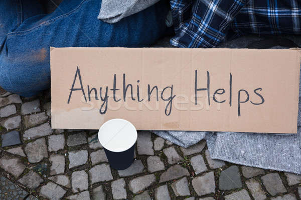 Elevated View Of Anything Helps Text On Cardboard Stock photo © AndreyPopov