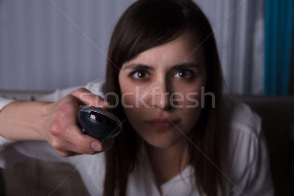 Femme télécommande jeune femme main Photo stock © AndreyPopov