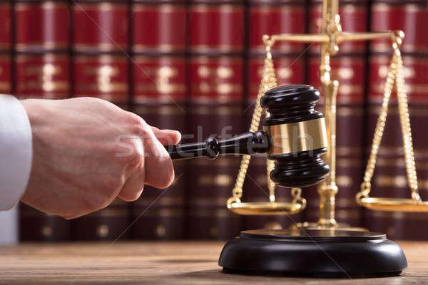 Judge Striking Mallet On Sounding Block Stock photo © AndreyPopov