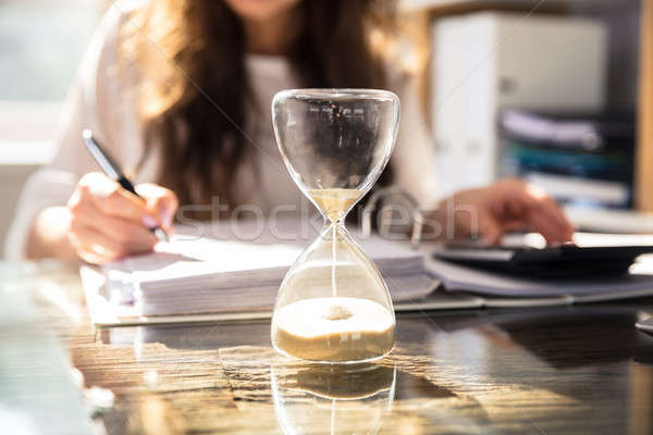 Close-up Of A Hourglass On Desk Stock photo © AndreyPopov