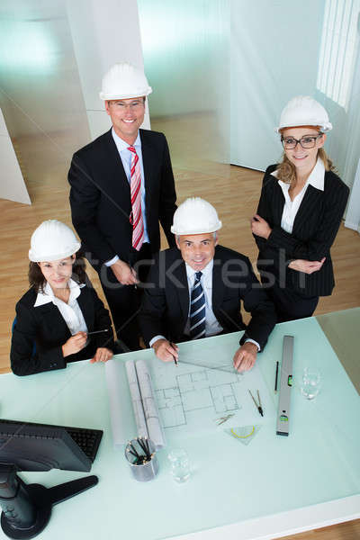 Architects discussing a blueprint Stock photo © AndreyPopov