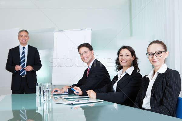 üzleti csapat tart megbeszélés mosolyog sikeres ül Stock fotó © AndreyPopov