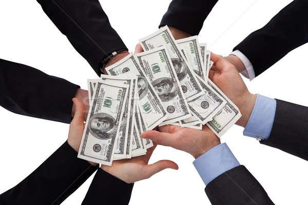 Csoport üzletemberek tart bankjegy fehér üzlet Stock fotó © AndreyPopov