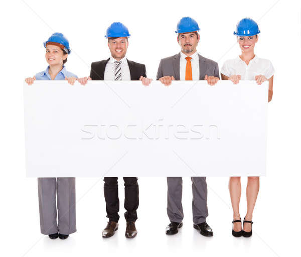 Halten Plakat Gruppe Zeile weiß Business Stock foto © AndreyPopov