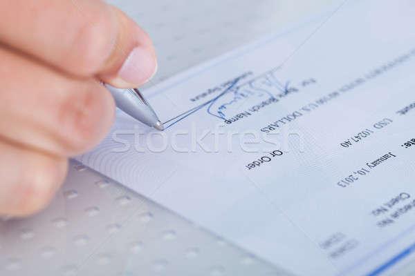 Main remplissage chèque Homme sur Photo stock © AndreyPopov