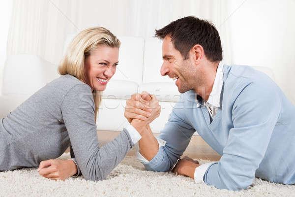 Man vrouw arm worstelen aantrekkelijk jonge man lachend Stockfoto © AndreyPopov