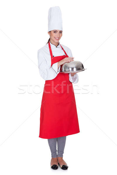 Happy Female Chef Holding Tray And Lid Stock photo © AndreyPopov