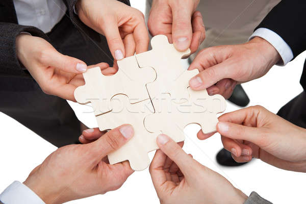 Business People Fixing Jigsaw Pieces Stock photo © AndreyPopov