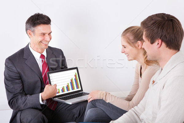 Advisor Showing Graph On Laptop To Couple Stock photo © AndreyPopov