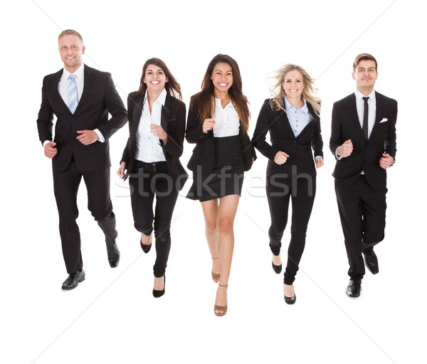 Portrait Of Welldressed Businesspeople Running Stock photo © AndreyPopov
