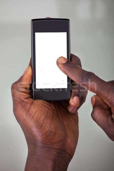 Persona teléfono celular primer plano ordenador mano Foto stock © AndreyPopov