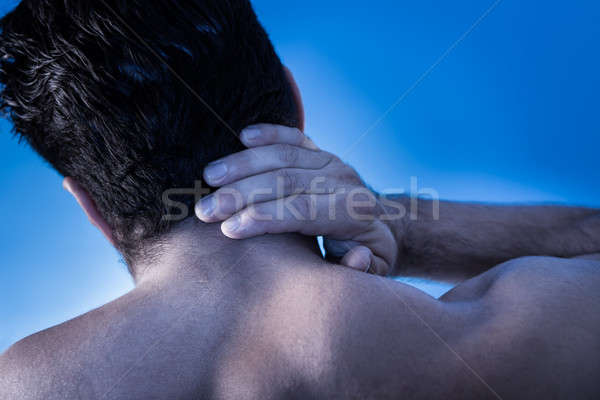 Man Suffering From Neck Pain Stock photo © AndreyPopov
