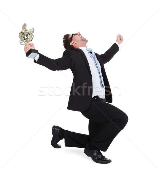 Sikeres fiatal üzletember trófea teljes alakos sikít Stock fotó © AndreyPopov